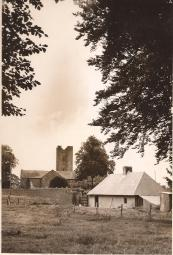 This view of The Church of Ireland and Barrack Lane. The cottage in the foreground was near the gate of Danescourt. Dated circa 1960 Courtesy Peter Coffey