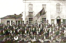 Athboy Brass Band circa 1939. Back Row: Andy Byrne, Dick McGurl (?), Pat Tuite, Joe Murphy, Johnny McClorey, Tom Coleman, Owen Garry, Willie Rabbit, ??, Joe Reilly, Alphie McConnell.Middle Row: John Farman (Bandmaster), Frank Sherlock, Patsy McGurl, Christie Tuit, Seamus Rabbit, Liam Sullivan, Tom Farrell, Frank Brogan, Tom Reilly. Front Row: P. Doherty, Jimmy (?) Lynch, Frank Sullivan, Paddy Reilly, Martin Doherty, Mick Perry, Tom Fitzpatrick, PJ ConnellCourtesy of Des White