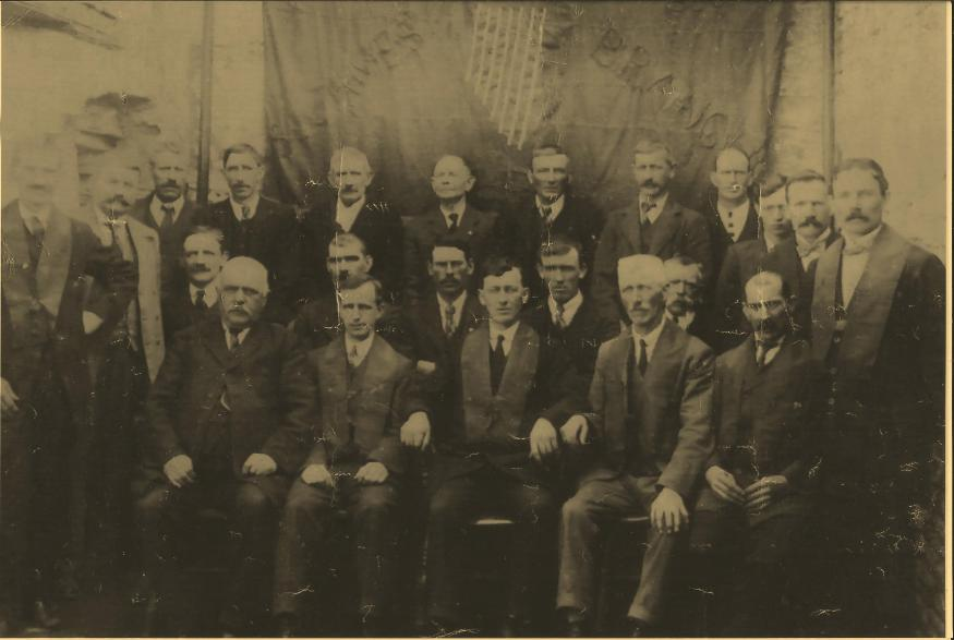Athboy Branch Ancient Order of Hibernians Standing back row L to R : unknown; Pat Peters; P Ward, Gillstown; Ml Fox, Otterstown; Rispin, Forge; unknown; John Fox, Castletown; Willie Reilly, Chapel St; Bill Doherty, Chapel St; unknown; Hugh Daly, Fair Green, Railway Guard; P Brennan, Trim Rd, Railway Man: Middle row seated ; unknown; unknown; unknown; Patrick Maye, Castletown, (Mason); Thomas Brown, Main Street, Harness maker: Front row: Garry, Connaught Street; unknown; unknown; James O'Brien, Connaught Street; Kellett:
