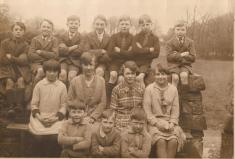 This school photo was taken at the Fair Green, probably opposite or very near to The Church of Ireland School there. The children are sitting on The Green wall. Only 3 children are named. In the front row L to R is Noel Kerr, Norman Coffey and Sydney Kerr. Courtesy of Peter Coffey