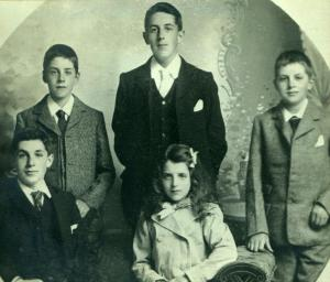 Portrait of the five Parr children dating from circa 1901. Standing left to right is Sidney John, Charles William and Victor Henry. Seated is Bernard Cecil and Alice Gladys.